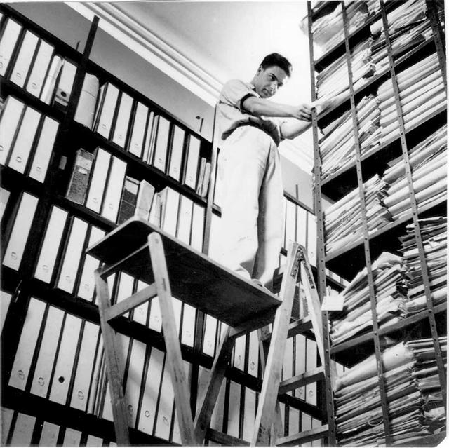 A member of CZA staff in the Archives' storeroom